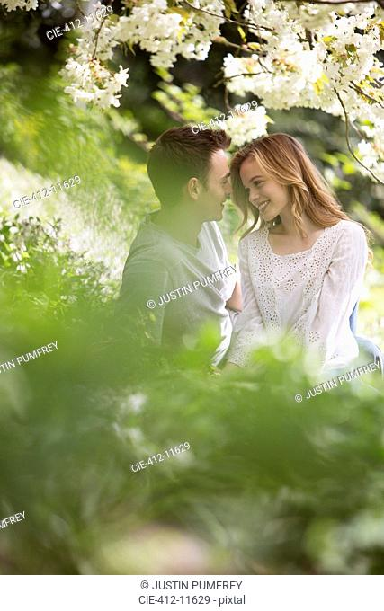 Couple relaxing in grass outdoors