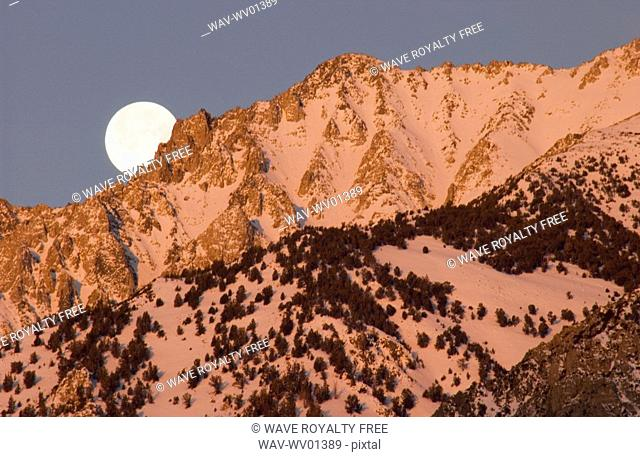 Moonset at Sunrise over the Sierra Mountains near Bishop, California