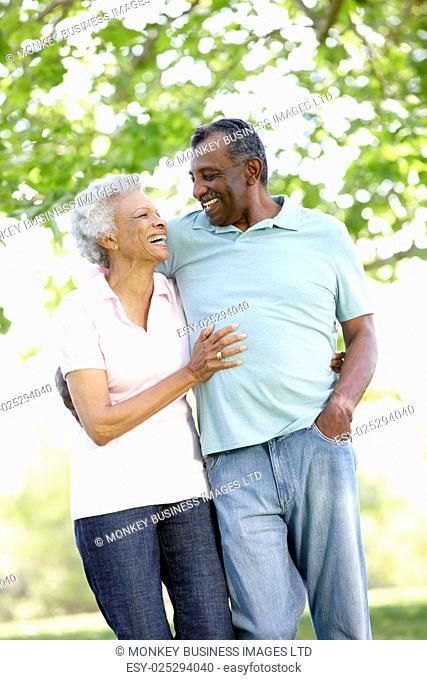 Romantic Senior African American Couple Walking In Park