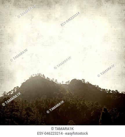 textured old paper background with landscape of central Gran Canaria