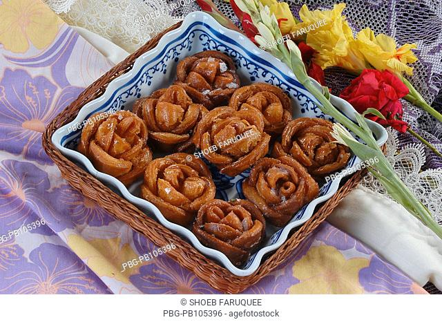 Pitha cakes: a sweetmeat of numerous varieties available in Bangladesh It is made of rice, pulse, milk and flour and mixed up with sugar and spices and fried in...