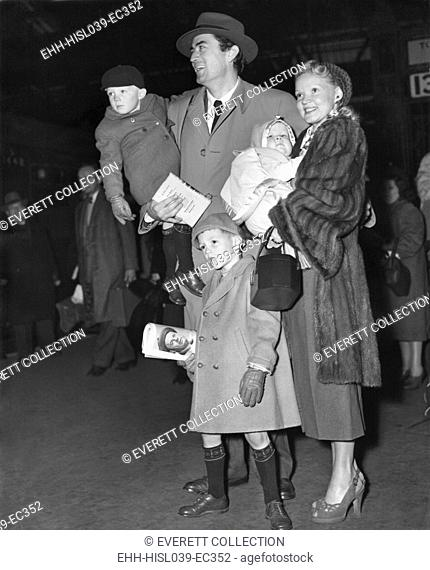 Actor Gregory Peck and his wife, Greta Kukkonen, and children on their arrival at Waterloo. Traveling on the Queen Elizabeth Boat Train, L-R: Jonathan