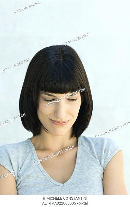 Young woman smirking, portrait
