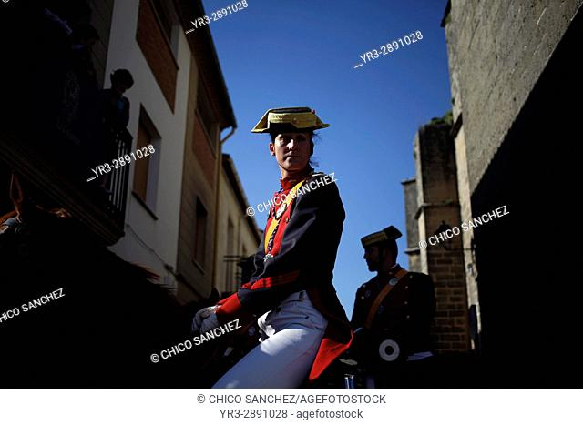 A female civil guard or guardia civil rides a horse during Easter Week celebrations in Baeza, Jaen Province, Andalusia, Spain