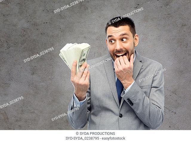 greedy businessman with american dollar money