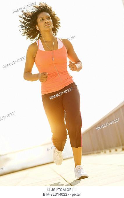 Mixed race woman jogging outdoors