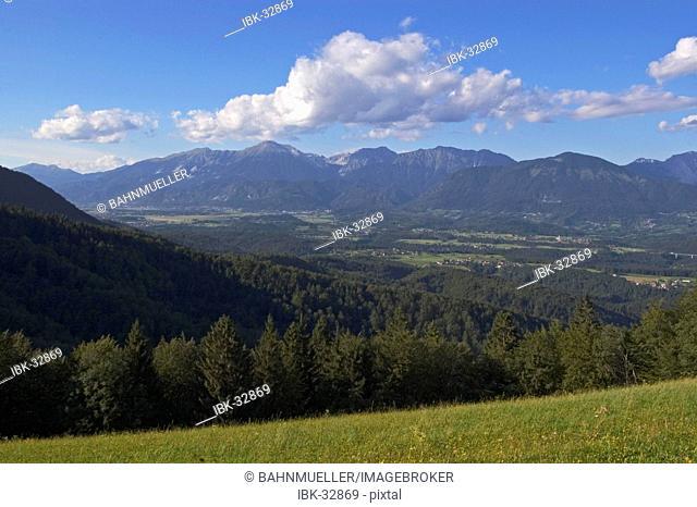 Near Kranj region Gorenjska view above the village Kropa to the plain of the river Sava and the Alps Karawanken Karavanke Slovenia