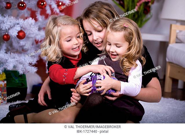 Girls unpacking Christmas presents