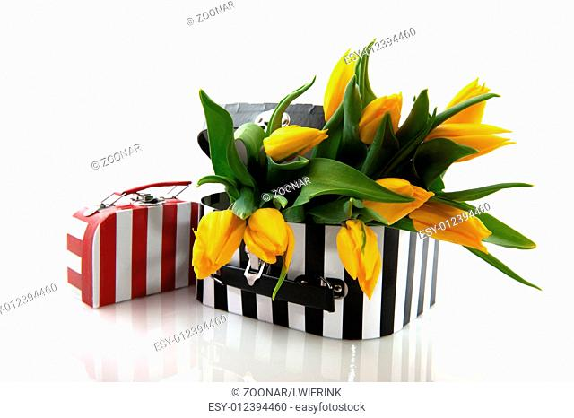 black and white suitcase with flowers
