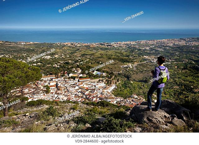 Hiker. Panoramic landscape, white villa of Mijas & Fuengirola. Malaga province Costa del Sol. Andalusia Southern Spain, Europe