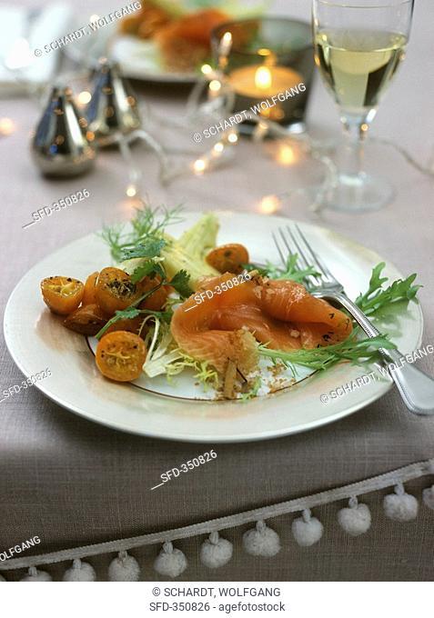 Marinated salmon on kumquat salad