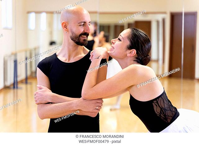 Couple smiling in ballet studio