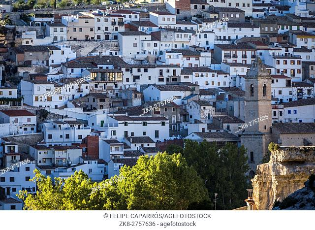 Panoramic view of typical houses of city during autumn, to the right church of San Andres, take in Alcala of the Jucar, Albacete province, Spain