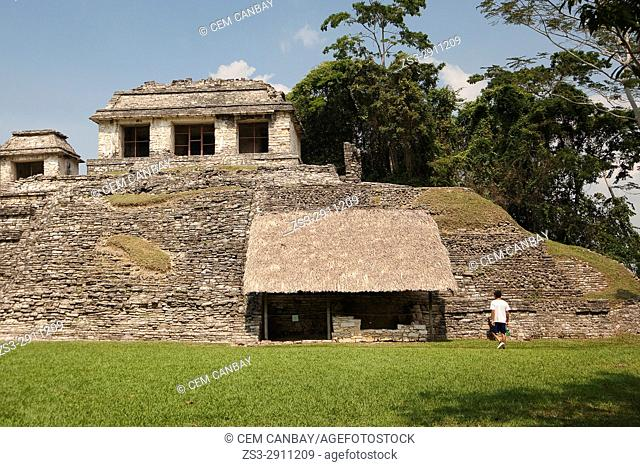 Tourist in front of the Grupo Norte in Palenque Archaeological Site, Palenque, Chiapas State, Mexico, Central America