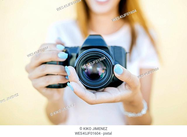 Close-up of woman's hands holding a camara