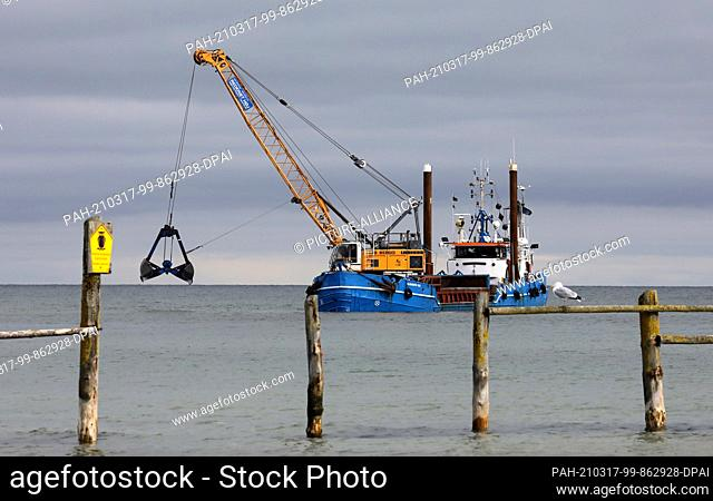 """16 March 2021, Mecklenburg-Western Pomerania, Darßer Ort: The dredger """"""""Elisabeth Høj"""""""" is in operation at the access to the harbour of refuge Darßer Ort in the..."""