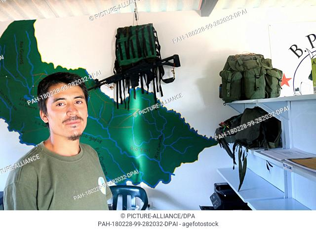 27 January 2018, Colombia, Agua Bonita: A former guerrilla fighter of the guerrilla organisation Farc stands in a small museum, which was set up at the library