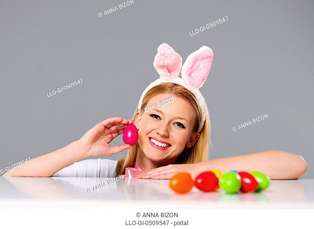 Blonde woman with bunny ears and Easter eggs Debica, Poland