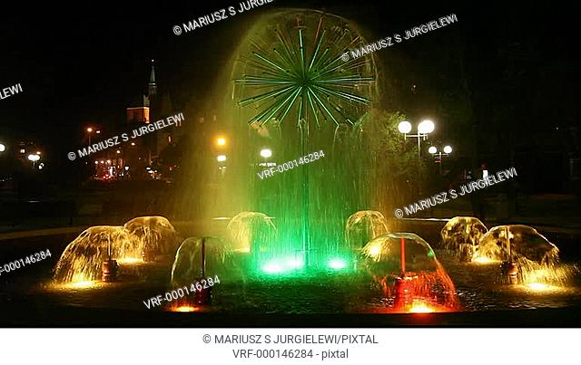Colorful, illuminated fountain in 18th of March Park, in Kolobrzeg