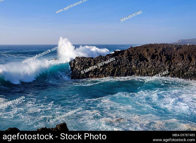 Surf on rocky coast, Los Hervideros, at Yaiza, Lanzarote, Canary Islands, Spain