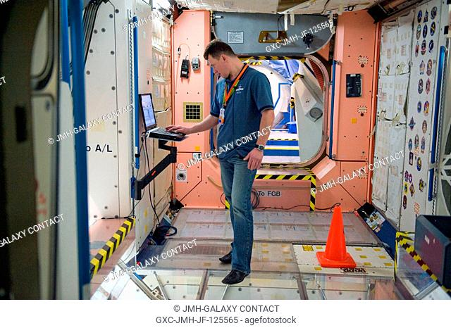 Cosmonaut Roman Romanenko, Expedition 2021 flight engineer, uses a computer during a training session in an International Space Station mock-uptrainer in the...