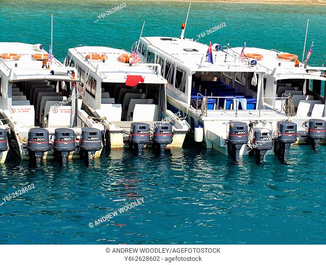 Big outboard motors power express water taxis Salang Beach Tioman Island Malaysia