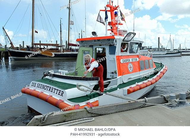 Barbara Donath of the German Maritime Search and Rescue Service leaves the rescue boat Casper Otten on the island of Langeoog, Germany, 14 August 2013