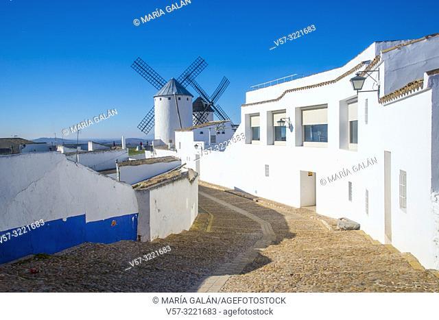 Street and windmills. Campo de Criptana, Ciudad Real province, Castilla La Mancha, Spain