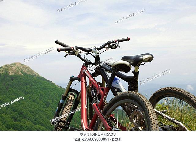 Mountain bikes against view of mountain