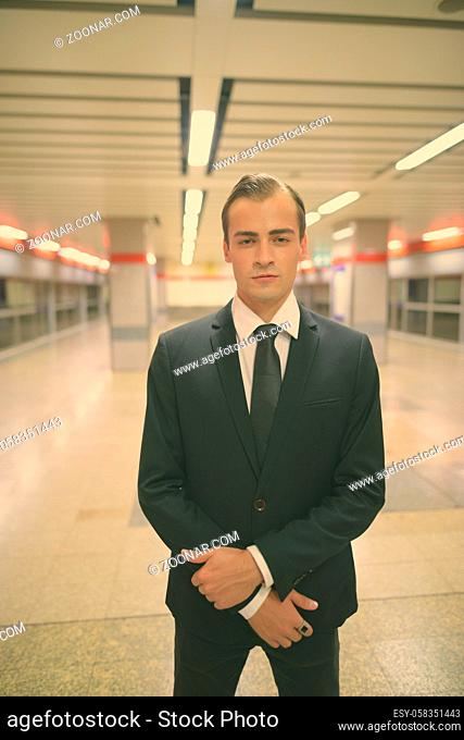 Portrait of young businessman exploring the city of Bangkok, Thailand