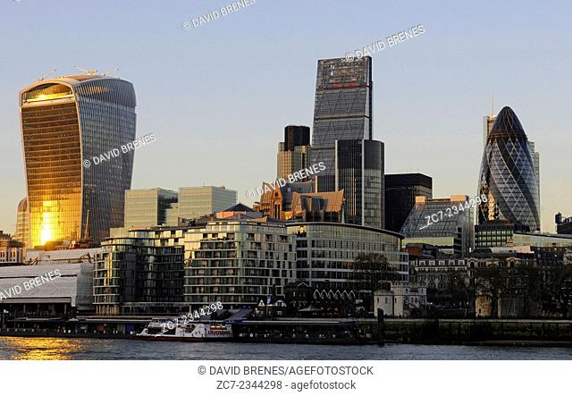 The Modern skyline of the City of London with The Walkie Talkie Building, The Gherkin, The Cheesegrater and River Thames at sundown London England