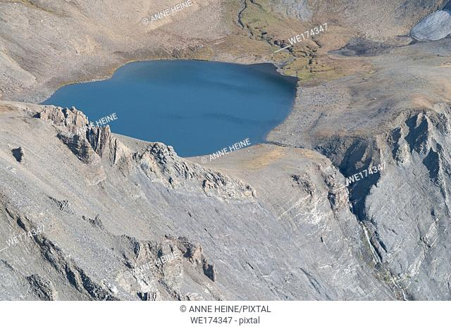 Tarn (Glacial lake) in rugged terrain above treeline. Taken from the canadian continental divide (Northover Ridge) fromAlberta towards British Columbia