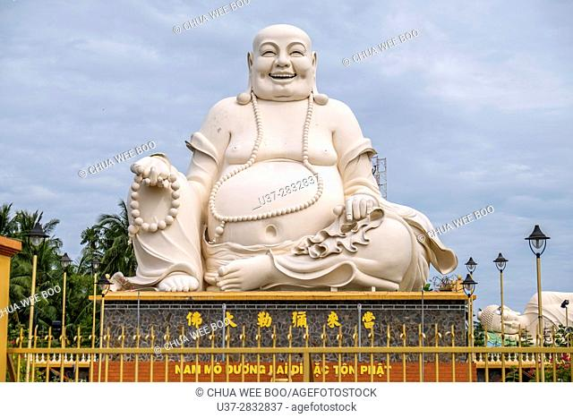 Vietnam, My Tho, Mekong Delta river area. Vinh Trang Pagoda complex, Big Happy Buddha statue (Nam Mo duong Lai Di Lac ton Phat)