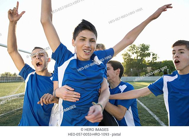 Soccer players cheering after win