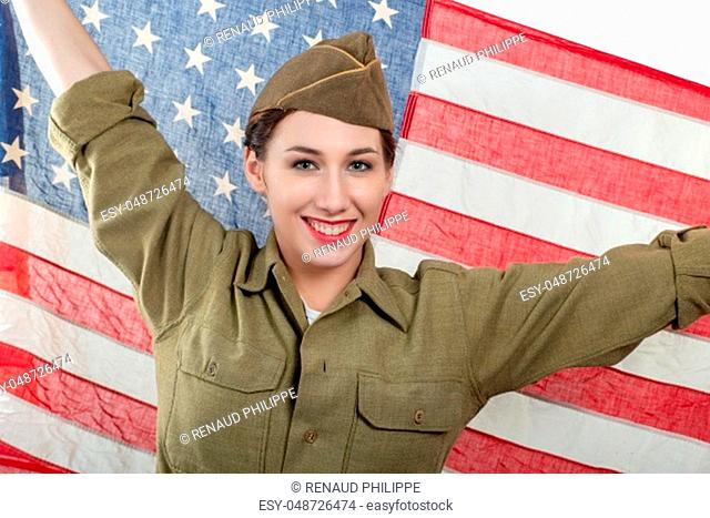 a pretty young woman in ww uniform us with american flag