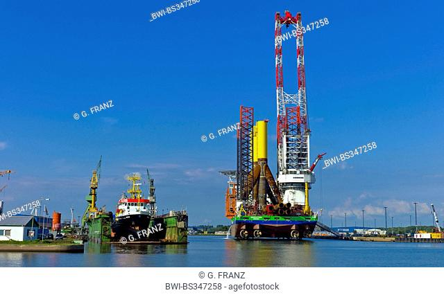 transport ship with tripos for offshore wind parks at harbour, Germany, Bremerhaven