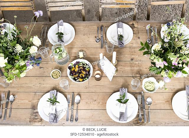 A styled table with flower arrangements