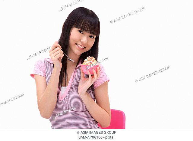 Young woman with bowl of ice cream
