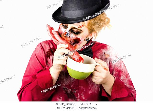 Woman eating bloody hand