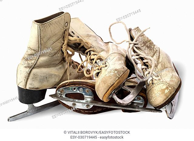 Pile of old female skates isolated on white background