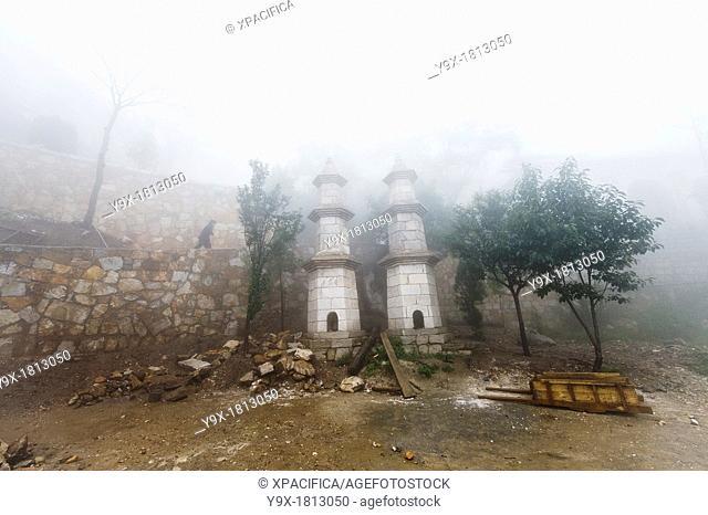 Fog covered pagodas at the San Huang Zhai Monastery on Song Mountain, China