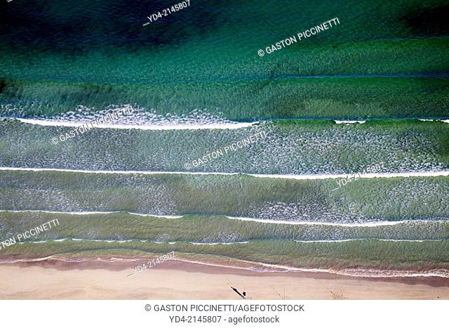 Aerial view of Alcudia Beaches. A person fishing on the coast, Alcudia Bay, Mallorca, Balearic Island, Spain