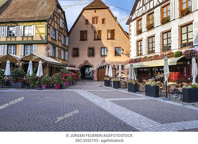 pedestrian zone in the old wine village Ribeauvillé, Alsace, France, square surrounded by old houses with sidewalk cafés