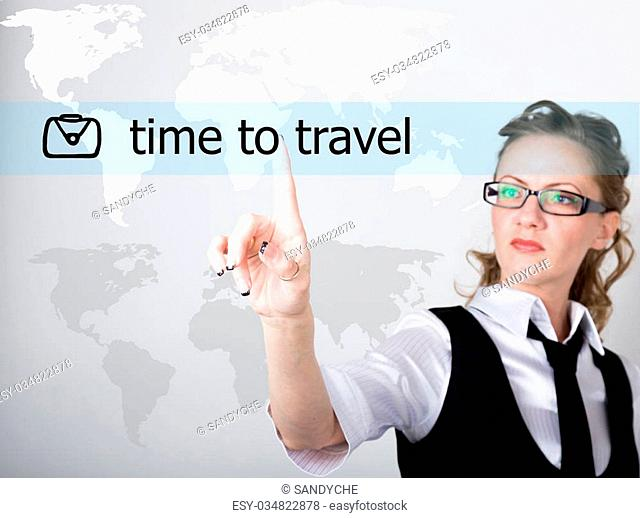 medical tourism written on a virtual screen. Internet technologies in business and tourism. woman in business suit and tie, presses a finger on a virtual screen
