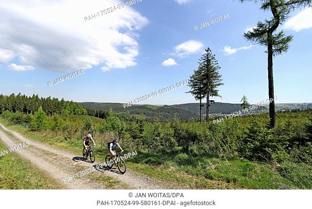 Trail keepers Kirsten Riedel (L) and Toni Escher cycle along the Stoneman Miriquidi near Breitenbrunn, Germany, 19 May 2017
