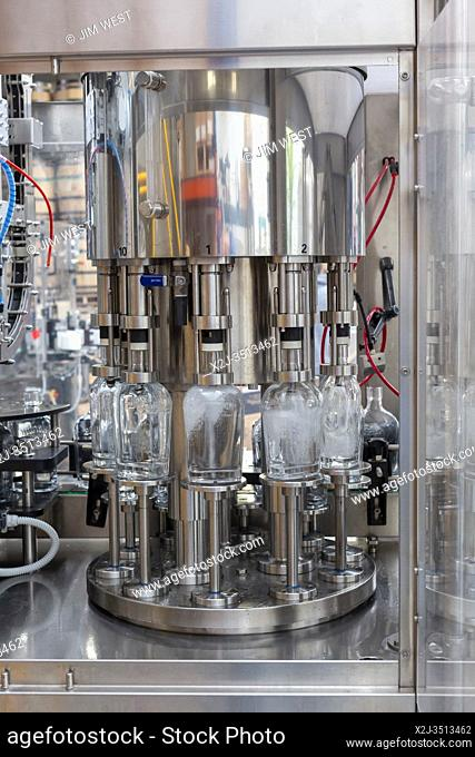 Ferndale, Michigan USA - 13 April 2020 - Bottles are filled with hand sanitizer at Valentine Distilling Co. The distillery has shut down its production of...