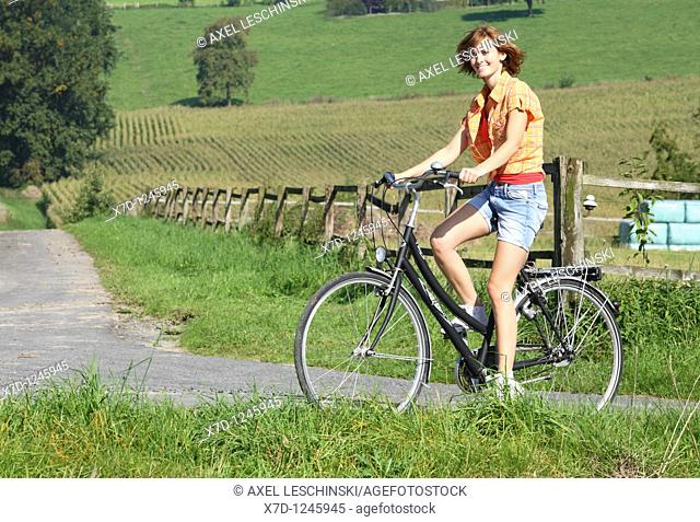 woman bicyle landscape summer germany