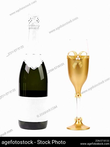 Champagne bottle and glass. Isolated on a white background