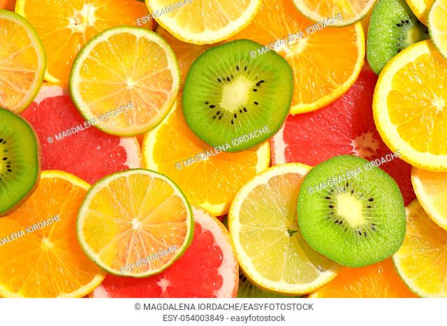 Fruit Slices Background With Lemon, Kiwi, Orange, Tangerine