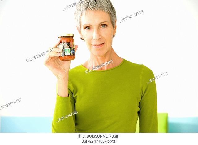 ORGANIC FOOD Model. 'Organic' tomato sauce